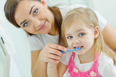 Mom and Daughter brushing their teeth - Pediatric Dentist in Lees Summit, MO